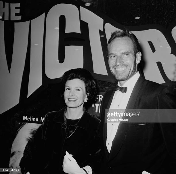 American actor and political activist Charlton Heston and American actress and photographer Lydia Clarke at the premiere of 'The Victors' US 1963