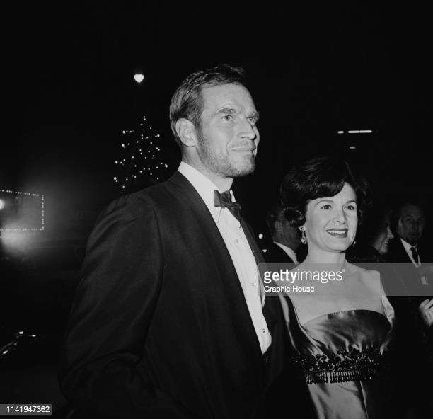 American actor and political activist Charlton Heston and American actress and photographer Lydia Clarke at the premiere of The Cardinal US 1963