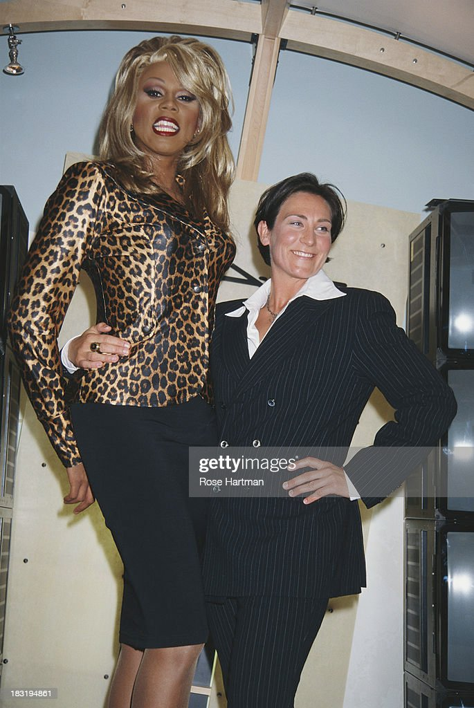 American actor and recording artist RuPaul (left) and Canadian pop and country singer-songwriter K.D. Lang attend a MAC Cosmetics party, 1996.