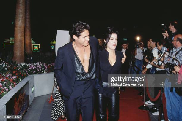 American actor and screenwriter Kevin Bernhardt and his wife American singer and actress Apollonia Kotero attend the premiere of 'Hellraiser III Hell...
