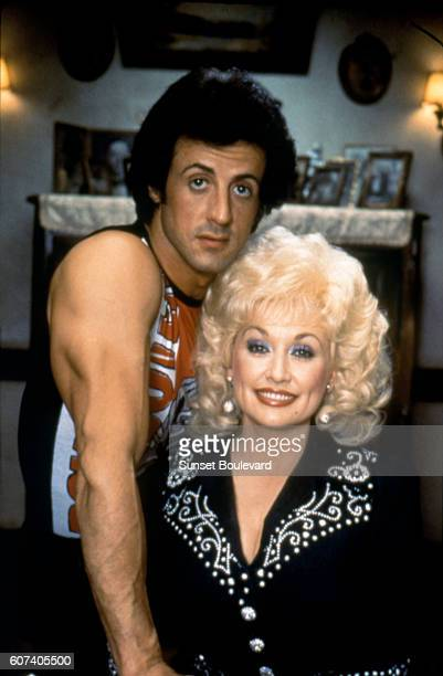 American actor and screenwriter Sylvester Stallone and singer songwriter and actress Dolly Parton on the set of Rhinestone directed by Bob Clark