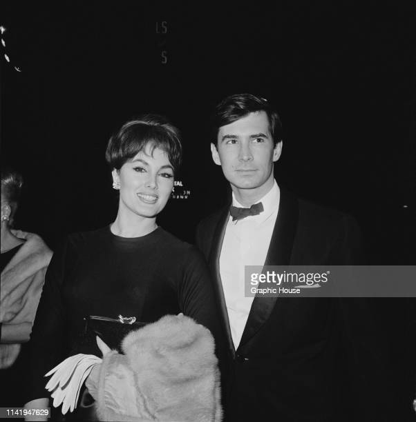 American actor and singer Anthony Perkins with American actress Charlene Holt at the premiere of 'Becket' US 1964