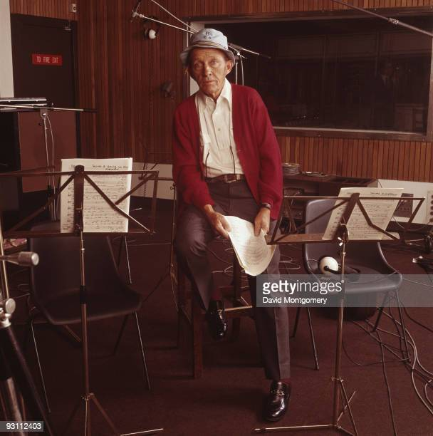 American actor and singer Bing Crosby in a recording studio 1975 He is holding the sheet music for the song 'Send in the Clowns'