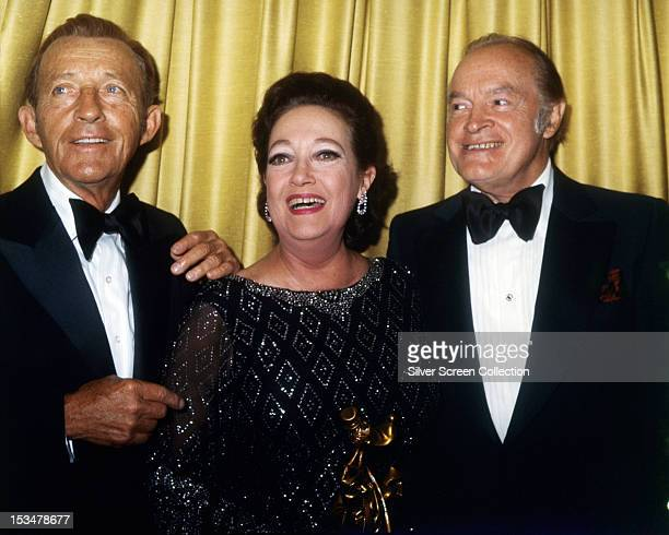 American actor and singer Bing Crosby with American actress Dorothy Lamour and comedian Bob Hope , circa 1975. The three made seven 'Road' movies...