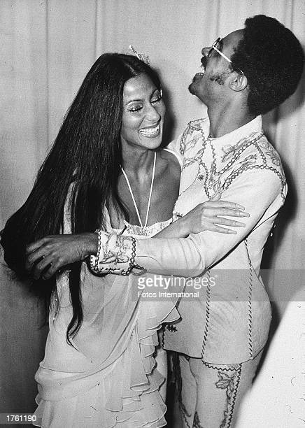 American actor and singer Cher and American singer and musician Stevie Wonder hug during the 16th Annual Grammy Awards held at the Hollywood Paladium...