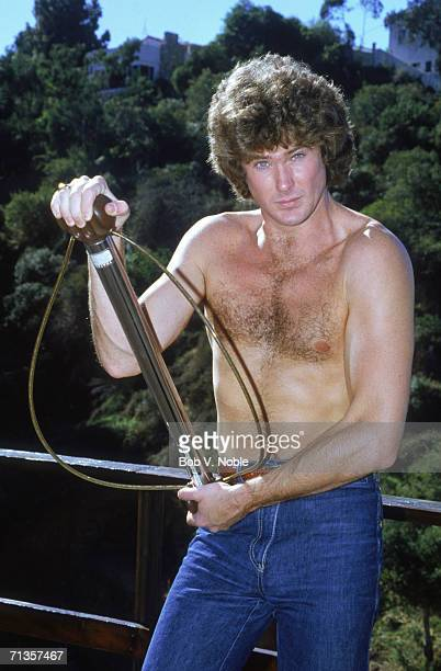 American actor and singer David Hasselhoff at home in Hollywood stripped to the waist posing with a bullworker 1979
