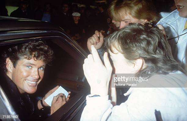 American actor and singer David Hasselhoff star of TV series 'Knight Rider' signing an autograph for a fan mid 1980s