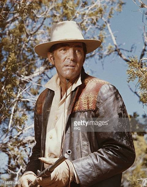 American actor and singer Dean Martin as Alex Flood in the western 'Rough Night in Jericho' 1967