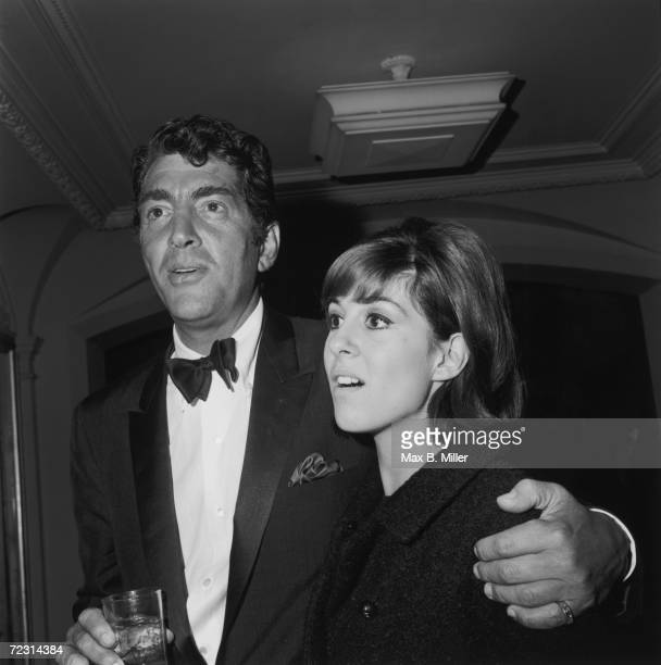 American actor and singer Dean Martin with his arm around his daughter Deana at a Hollywood event, December 1965.