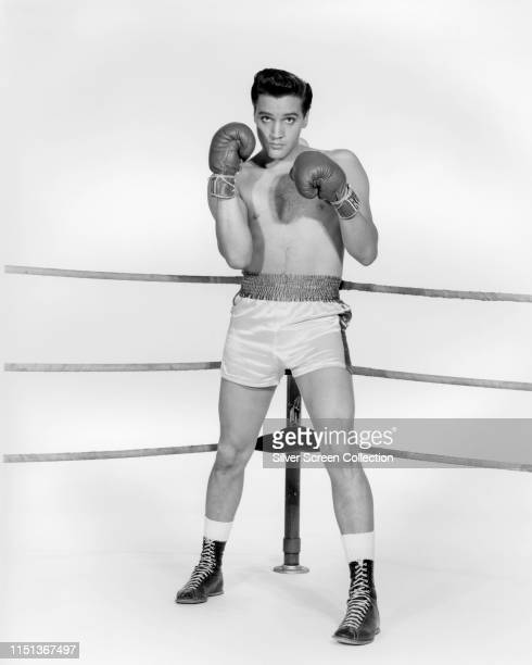 American actor and singer Elvis Presley as boxer Walter Gulick in a promotional shot for the musical film 'Kid Galahad' 1962