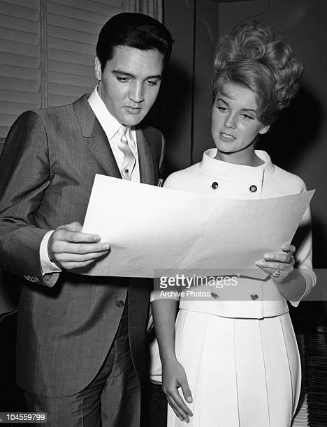 American actor and singer Elvis Presley with Swedish born American actress and singer Ann Margret at MGM studios rehearsing lines for the film 'Viva...