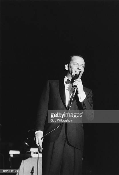 American actor and singer Frank Sinatra performing on stage at the Sands hotel in Las Vegas, February 1960.