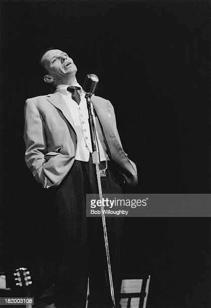 American actor and singer Frank Sinatra performs on stage at University High School in Los Angeles, October 1955. Sinatra's daughter, Nancy was a...