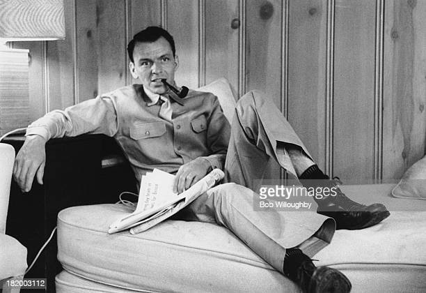 American actor and singer Frank Sinatra smoking a pipe on the set of 'From Here to Eternity' directed by Fred Zinnemann 1953