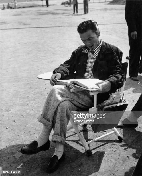 American actor and singer Frank Sinatra studies the script between takes on the set of the film 'It Happened in Brooklyn', 1947.