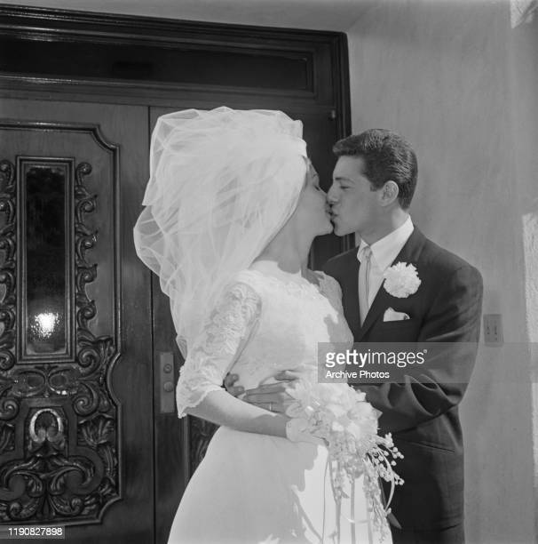 American actor and singer Frankie Avalon with his bride Kathryn 'Kay' Diebel after their wedding in North Hollywood California 19th January 1963