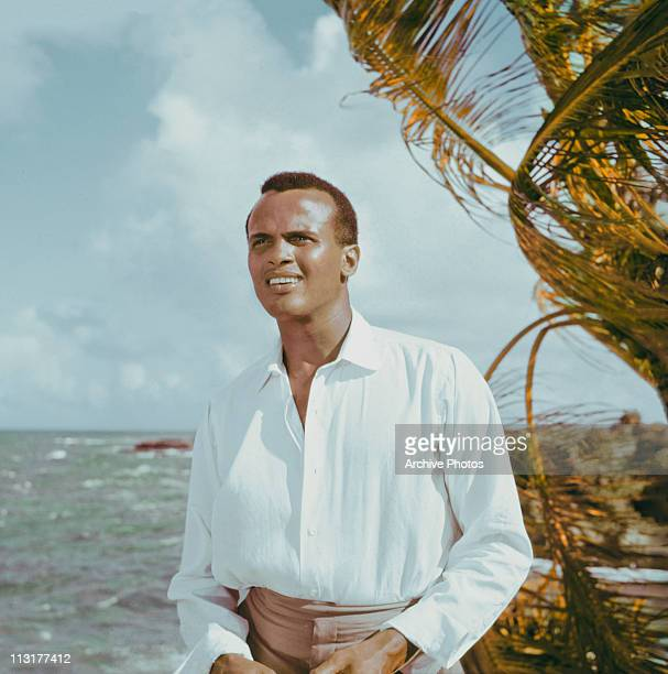 American actor and singer Harry Belafonte poses next to the ocean circa 1957
