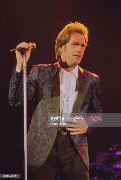 American actor and singer Huey Lewis performs live on stage with Huey Lewis and the News in London in June 1994