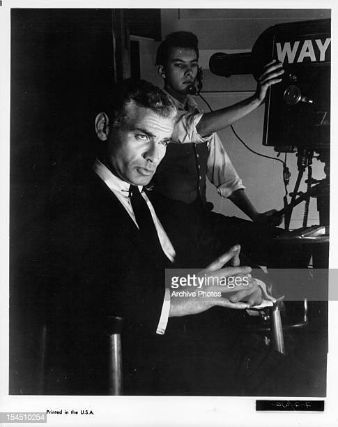 American actor and singer Jeff Chandler with a movie camera behind him circa 1950