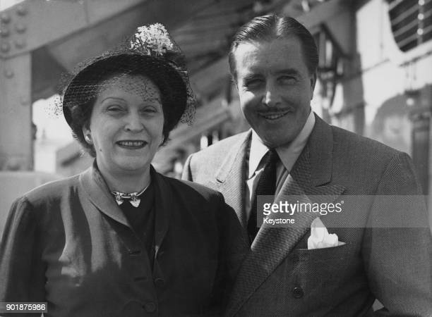 American actor and singer John Boles and his wife Marcelite arrive at Southampton on board the 'Caronia' 28th July 1949