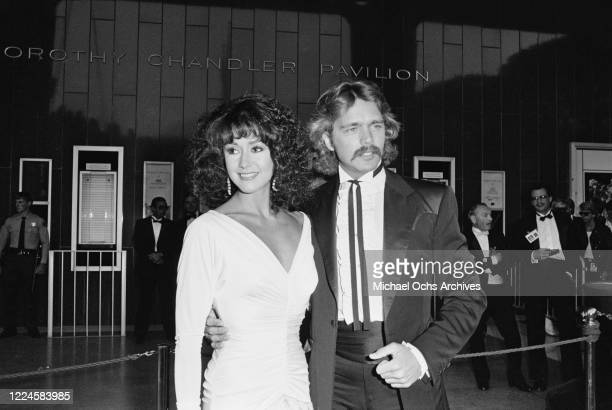American actor and singer John Schneider with his wife Tawny Little during the 57th Academy Awards at the Dorothy Chandler Pavilion in Los Angeles,...