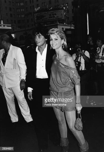 American actor and singer Olivia Newton-John and her boyfriend, actor Matt Lattanzi, arriving at the premiere of 'Staying Alive' at Mann's Chinese...