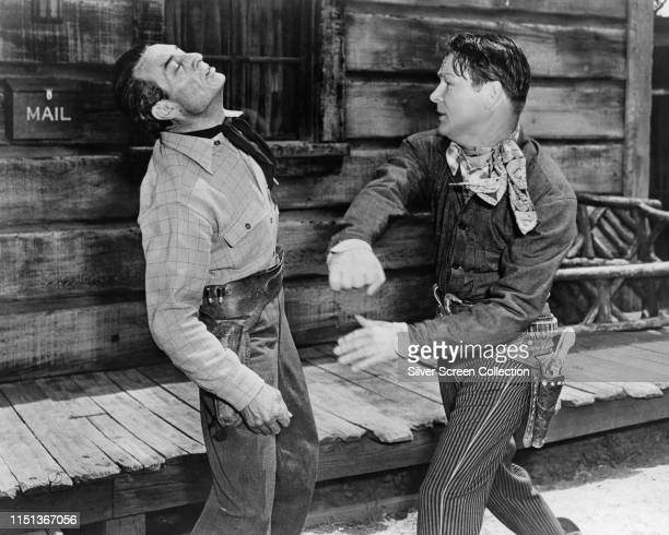 American actor and singer Roy Rogers and Anthony Caruso in a fight scene from the Western 'Pals of the Golden West', 1951.