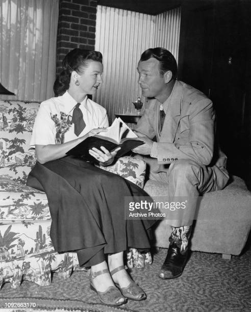 American actor and singer Roy Rogers and his wife, actress Dale Evans, reading the Bible together, circa 1950. Rogers is a layman sponsor of the...