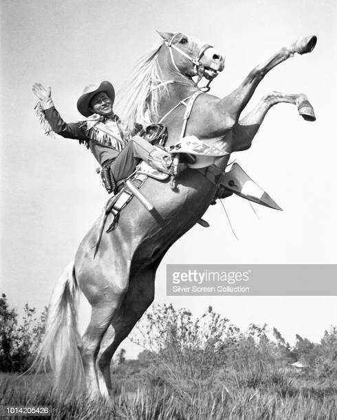 American actor and singer Roy Rogers on his golden palomino Trigger circa 1945
