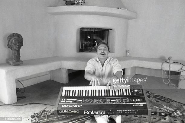 MALIBU JANUARY 1980 American actor and star of TV series Mike Hammer Stacy Keach plays keyboard in living room of home he shares with with third wife...
