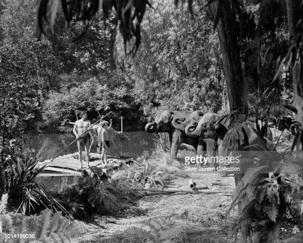 American actor and swimmer Johnny Weissmuller as Tarzan and Johnny Sheffield as Boy in a scene from the film 'Tarzan and the Amazons' 1945