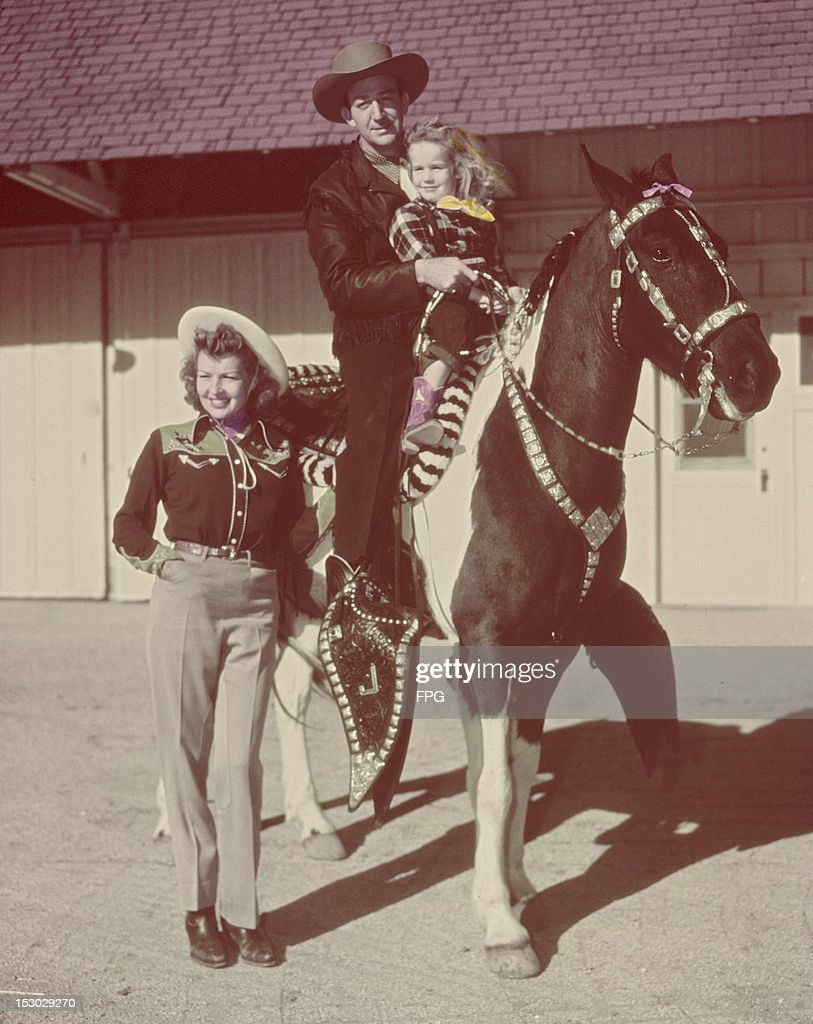 American actor and trumpeter Harry James (1916 - 1983) with his wife, actress Betty Grable (1916 - 1973), at their ranch, the Baby J Ranch in San Fernando Valley, California, circa 1950.