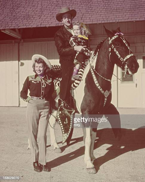 American actor and trumpeter Harry James with his wife actress Betty Grable at their ranch the Baby J Ranch in San Fernando Valley California circa...