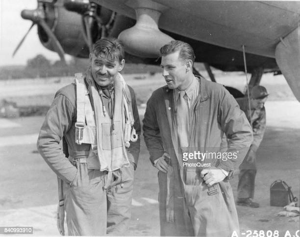 American actor and US Army Air Corps gunner Capt Clark Gable and copilot Lt Col Robert W Burns both of the USAAC Boeing B17 'The Duchess' discuss...