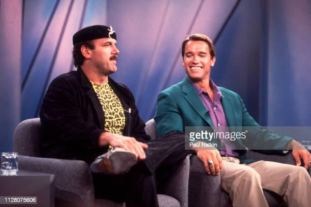 American actor and wrestler Jesse Ventura AustrianAmerican actor and bodybuilder Arnold Schwarzenegger promote their film 'Predator' on an episode of...