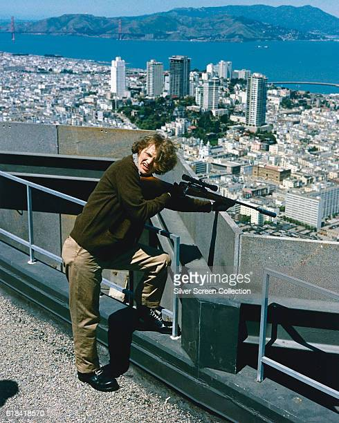 American actor Andrew Robinson as serial killer 'Scorpio' in the action film 'Dirty Harry' directed by Don Siegel 1971 Here he targets his victim...