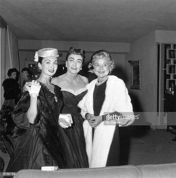 American actor Ann Blyth American actor Joan Crawford and Norwegian figure skater and actor Sonja Henie pose together at a Hollywood event Hollywood...