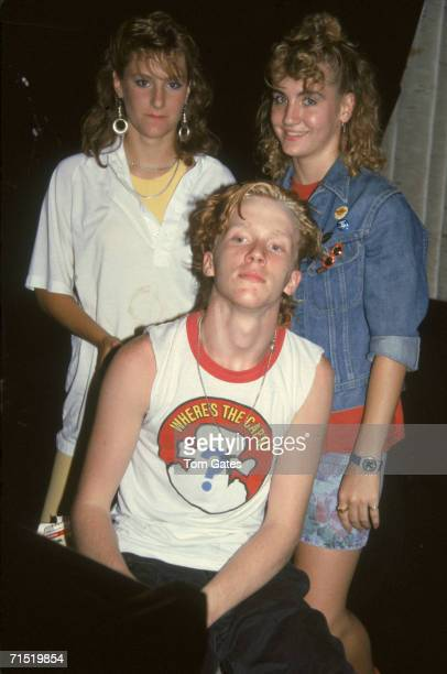 American actor Anthony Michael Hall poses for a photograph as he sits in a sleeveless Cap'n Crunch tshirt before two teenaged girls at the...