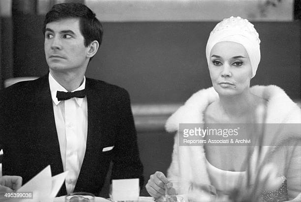 American actor Anthony Perkins and French actress Ludmilla Tchà©rina sitting at the table at the Paris Opera Gala for the presentation of the film...