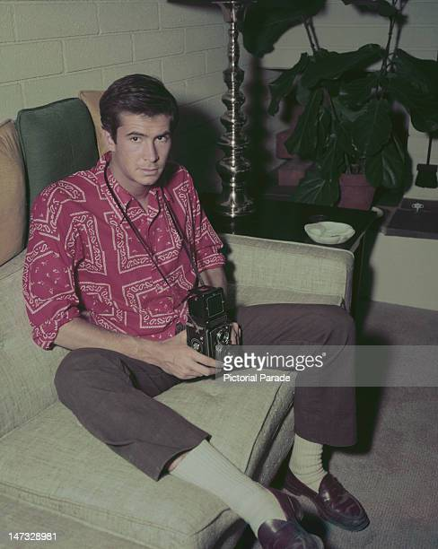 American actor Anthony Perkins holding a Rolleiflex twin lens reflex camera circa 1960