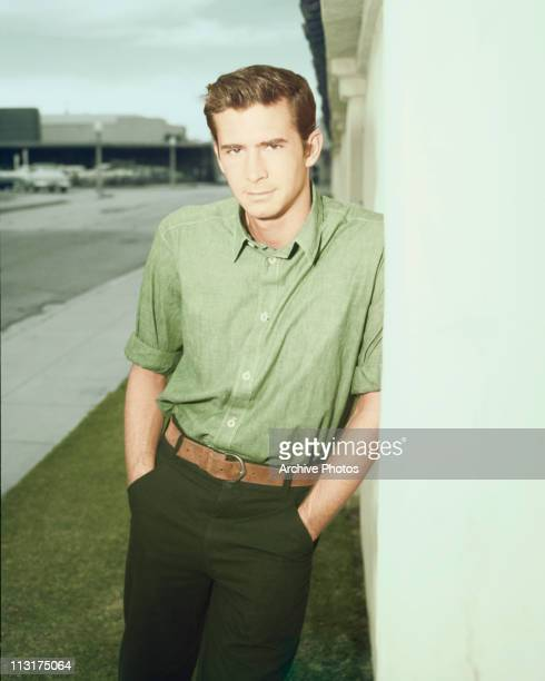 American actor Anthony Perkins poses against a wall circa 1960