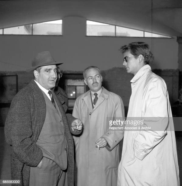 American actor Anthony Perkins talking to two men at Ciampino Airport Rome 18th February 1957