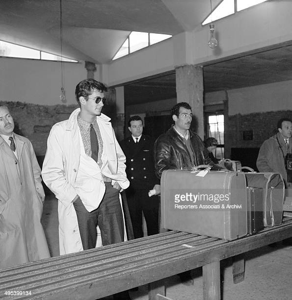 American actor Anthony Perkins waiting for his luggage at Ciampino Airport Rome 18th February 1957