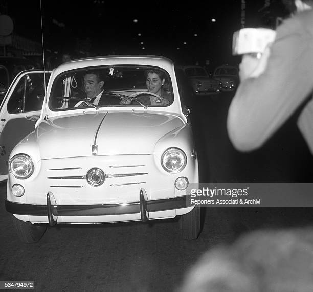 American actor Anthony Quinn driving a car with his wife Jolanda Addolori. Italy, 1959