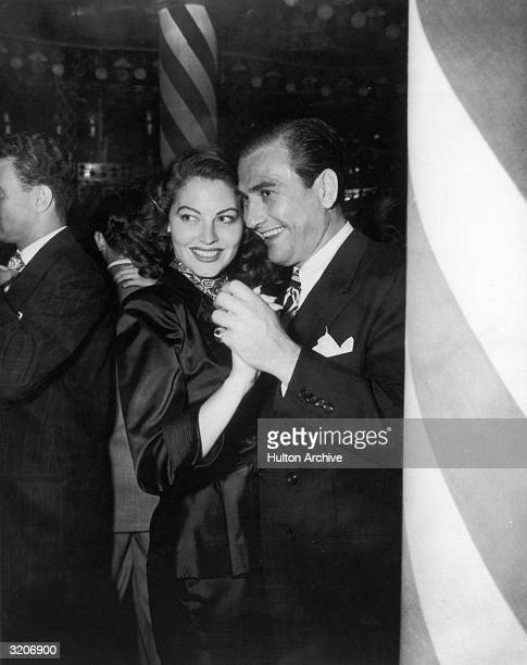 American actor Ava Gardner dances with jazz musician and bandleader Artie Shaw at the Mocambo Hollywood California circa 1944 The couple married the...