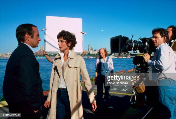 American actor Ben Gazzara and British actress Audrey Hepburn perform as film director Peter Bogdanovich looks through a camera lens on the set of...