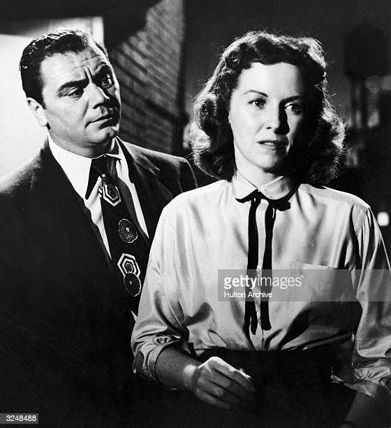 American actor Betsy Blair stands with her back to American actor Ernest Borgnine in a still from the film 'Marty' directed by Delbert Mann