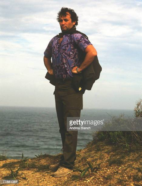American actor Bill Murray as he stands, hands on hips, on a sea-side cliff-edge during a photoshoot for Rolling Stone magazine, 1981.