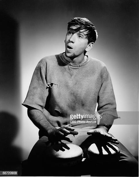 American actor Bob Denver plays the bongos as he poses in character as Maynard G Krebs the Beatnik from the televison situation comedy 'The Many...