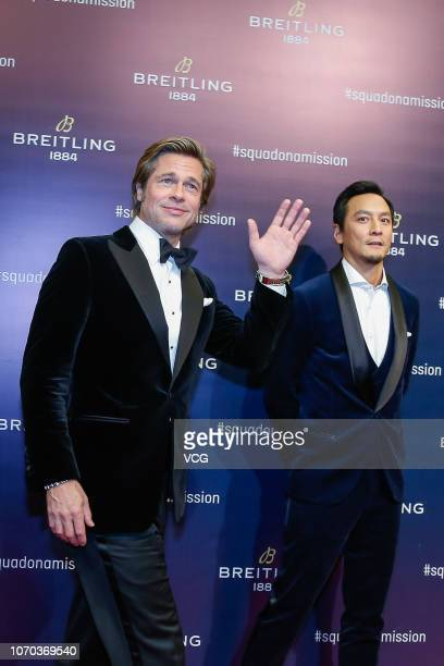 American actor Brad Pitt and actor Daniel Wu Yanzu attend Breitling Squadona Mission event on November 20 2018 in Beijing China